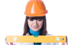 Woman in helmet wyh level Royalty Free Stock Image