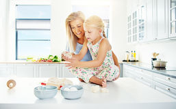 Woman helping child with bread dough Royalty Free Stock Images