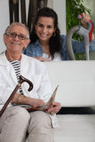 Woman helping an elderly lady Royalty Free Stock Photography