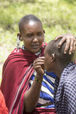 Woman helping girl, Maasi Village, Ngorongoro Conservationa Area Royalty Free Stock Photos