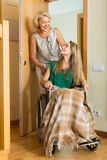 Woman helping handicapped girl Royalty Free Stock Photo