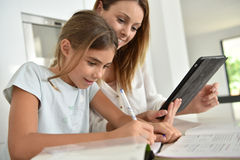 Woman helping her daughter with homework Royalty Free Stock Photo