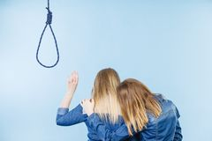 Woman helping her friend with suicidal thoughts. Woman trying to help her best friend with suicidal thoughts. Friendship and depression concept stock photo