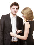 Woman helping man dress up elegant clothes. Royalty Free Stock Photography