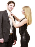 Woman helping man dress up elegant clothes. Royalty Free Stock Images