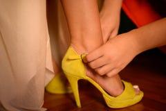 Free Woman Helping Model To Tie Her High Heel Shoe Stock Image - 105395421