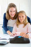 Woman helping out her little sister for homework Royalty Free Stock Photos
