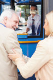 Woman Helping Senior Man To Board Bus Royalty Free Stock Photo