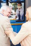 Woman Helping Senior Man To Board Bus royalty free stock photo