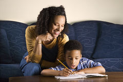 Woman Helping Son with Homework Stock Images