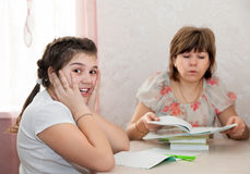 Woman helping   to   teenager to learn   lessons Royalty Free Stock Photo