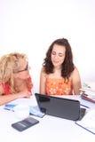 Woman helping young girl Stock Photos
