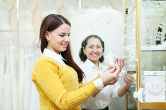 Woman helps  girl in choosing  accessories Royalty Free Stock Photo