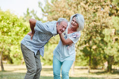 Woman helps old man with back pain Stock Images