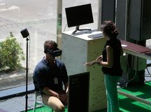 Vr sets at sonar. A woman helps people to test different virtual reality models and environments during sonar advanced music and arts in barcelona Royalty Free Stock Photo