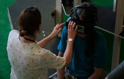 Vr sets at sonar. A woman helps people to test different virtual reality models and environments during sonar advanced music and arts in barcelona Royalty Free Stock Photography