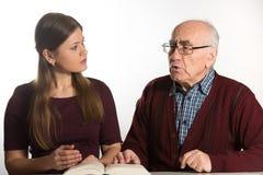 Woman helps senior man Royalty Free Stock Photography