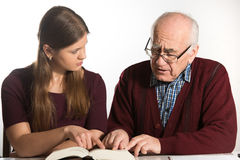 Woman helps senior man Stock Photos