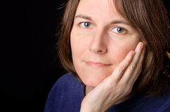 Woman in her 40's. Closeup portrait of a middle aged woman Stock Images