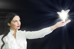 Woman with her angel Stock Photography