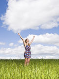 Woman with her arms raised Stock Photo