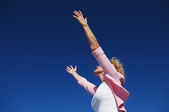Woman with her arms wide open Royalty Free Stock Images
