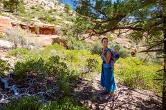 A woman with her baby boy are trekking in Zion national park, Ut Stock Photo