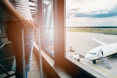 Woman with her baggage waiting for her flight Royalty Free Stock Images