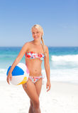 Woman with her ball on the beach Royalty Free Stock Image