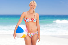 Woman with her ball on the beach Stock Photography