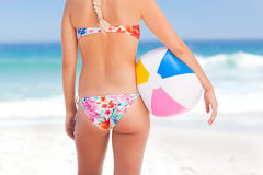 Woman with her ball on the beach Stock Photo