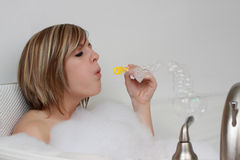Woman in her bath Stock Photography