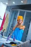 Woman in her bathroom Royalty Free Stock Image