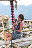 Woman with her beautiful beagle dog in nature of tropical Bali island, Indonesia. Travelling with dog concept. Royalty Free Stock Photos
