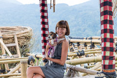 Woman with her beautiful beagle dog in nature of tropical Bali island, Indonesia. Travelling with dog concept. Royalty Free Stock Photography
