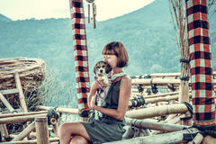 Woman with her beautiful beagle dog in nature of tropical Bali island, Indonesia. Travelling with dog concept. Royalty Free Stock Image