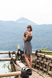 Woman with her beautiful beagle dog in nature of tropical Bali island, Indonesia. Travelling with dog concept. Stock Photo