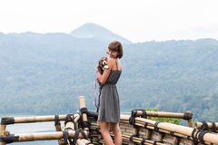 Woman with her beautiful beagle dog in nature of tropical Bali island, Indonesia. Travelling with dog concept. Stock Images