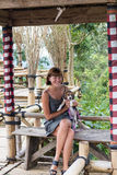 Woman with her beautiful beagle dog in nature of tropical Bali island, Indonesia. Travelling with dog concept. stock photography