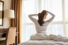 Woman in her bedroom in the morning Royalty Free Stock Photography