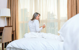 Woman in her bedroom in the morning Stock Images