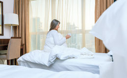 Woman in her bedroom in the morning Royalty Free Stock Photo