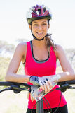 Woman with her bicycle. In the countryside Stock Photos