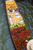 Woman and her boat in floating market, Thailand Stock Photography