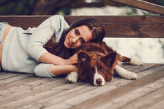 Woman with her border collie dog Royalty Free Stock Photos