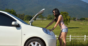 Woman with her broken car Stock Photography