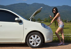 Woman with her broken car Stock Images