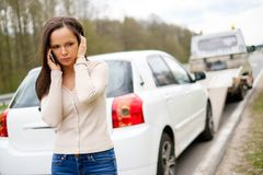 Woman and her broken car on a roadside Royalty Free Stock Photography