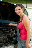 Woman with her broken down car Royalty Free Stock Photography