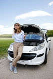 Woman with her broken down car Royalty Free Stock Photos